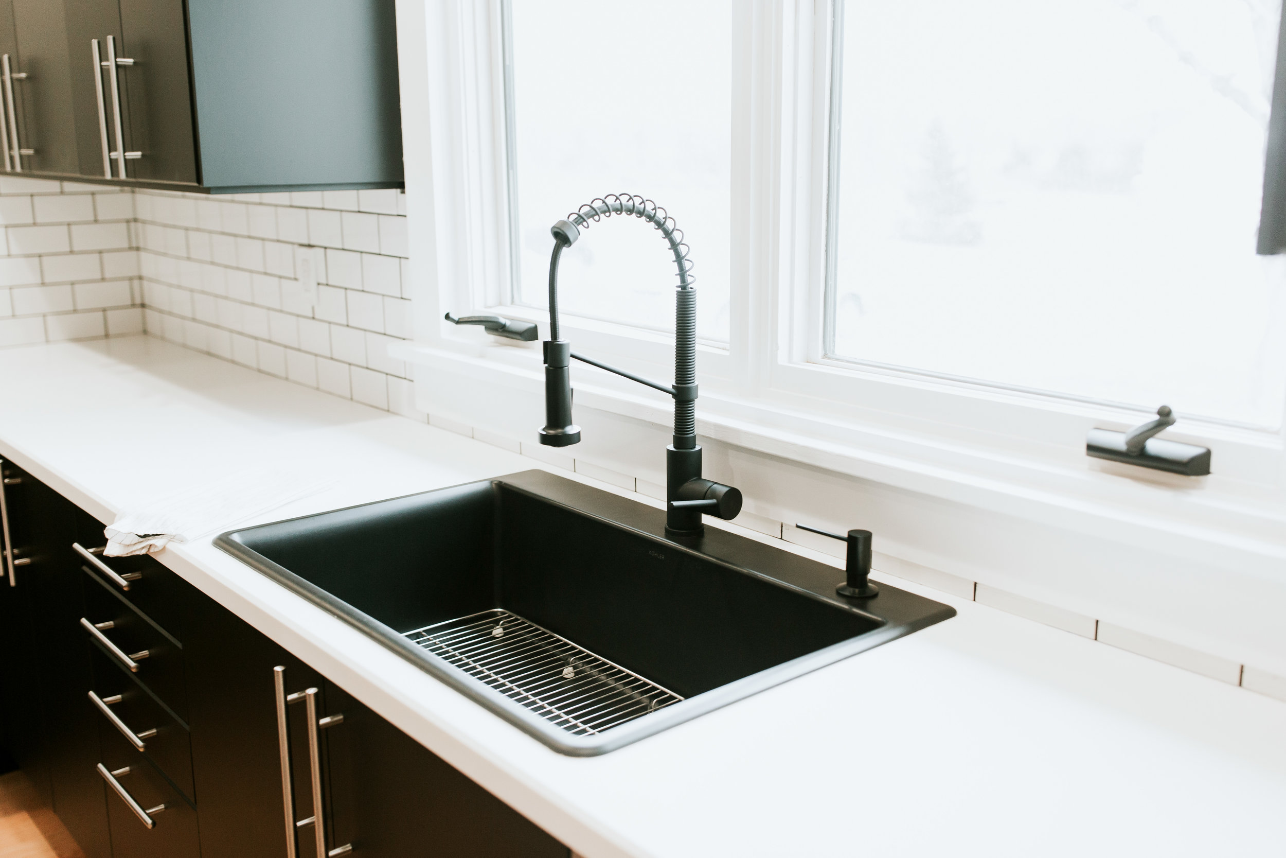 modern kitchen sources - Ikea kungsbacka cabinets, subway tile, black sink, white countertops, black faucet