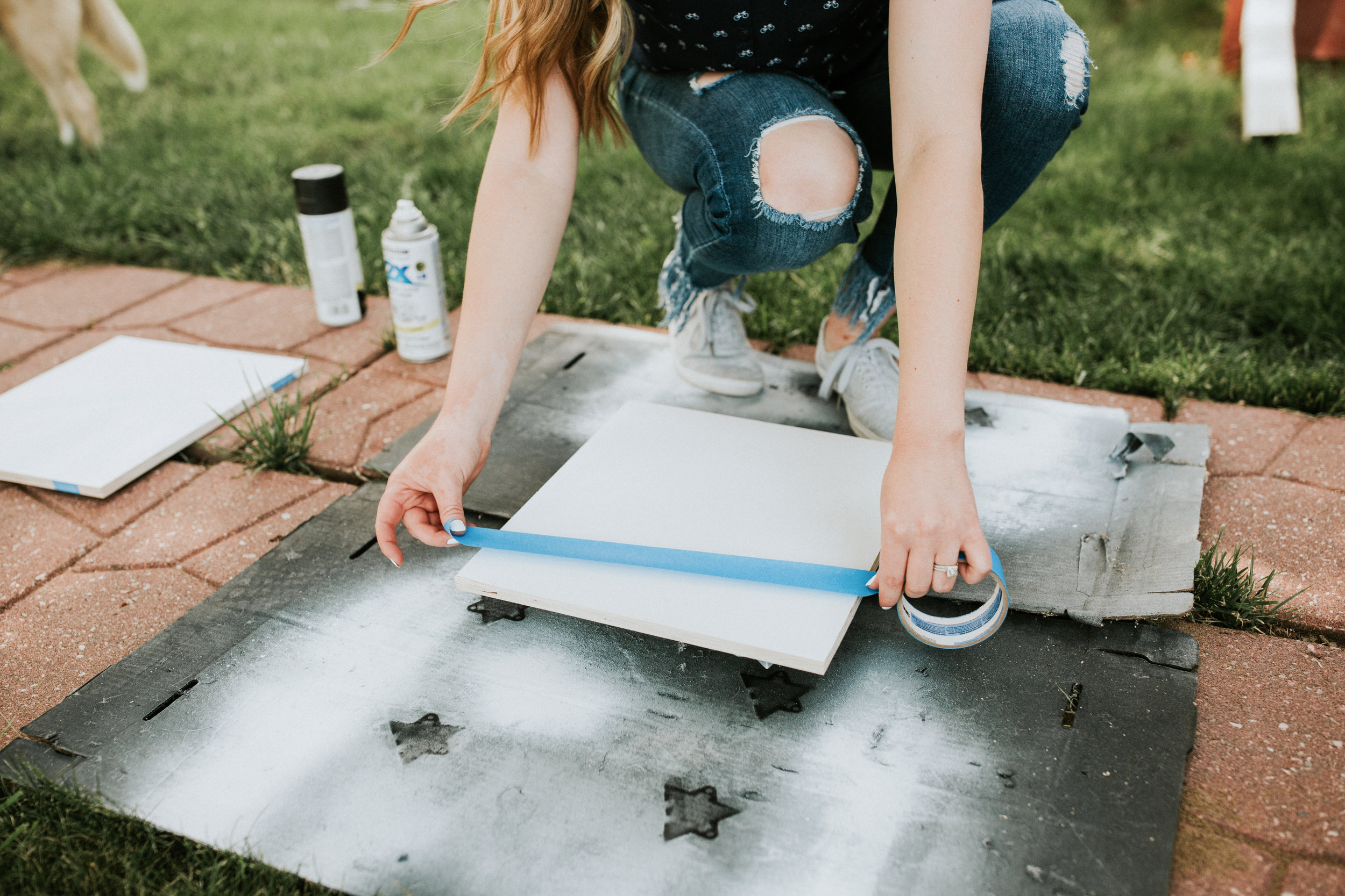 Step 2: Tape the surface  - Tape the wall, furniture piece, artwork...whatever it is that you're painting with your desired pattern.