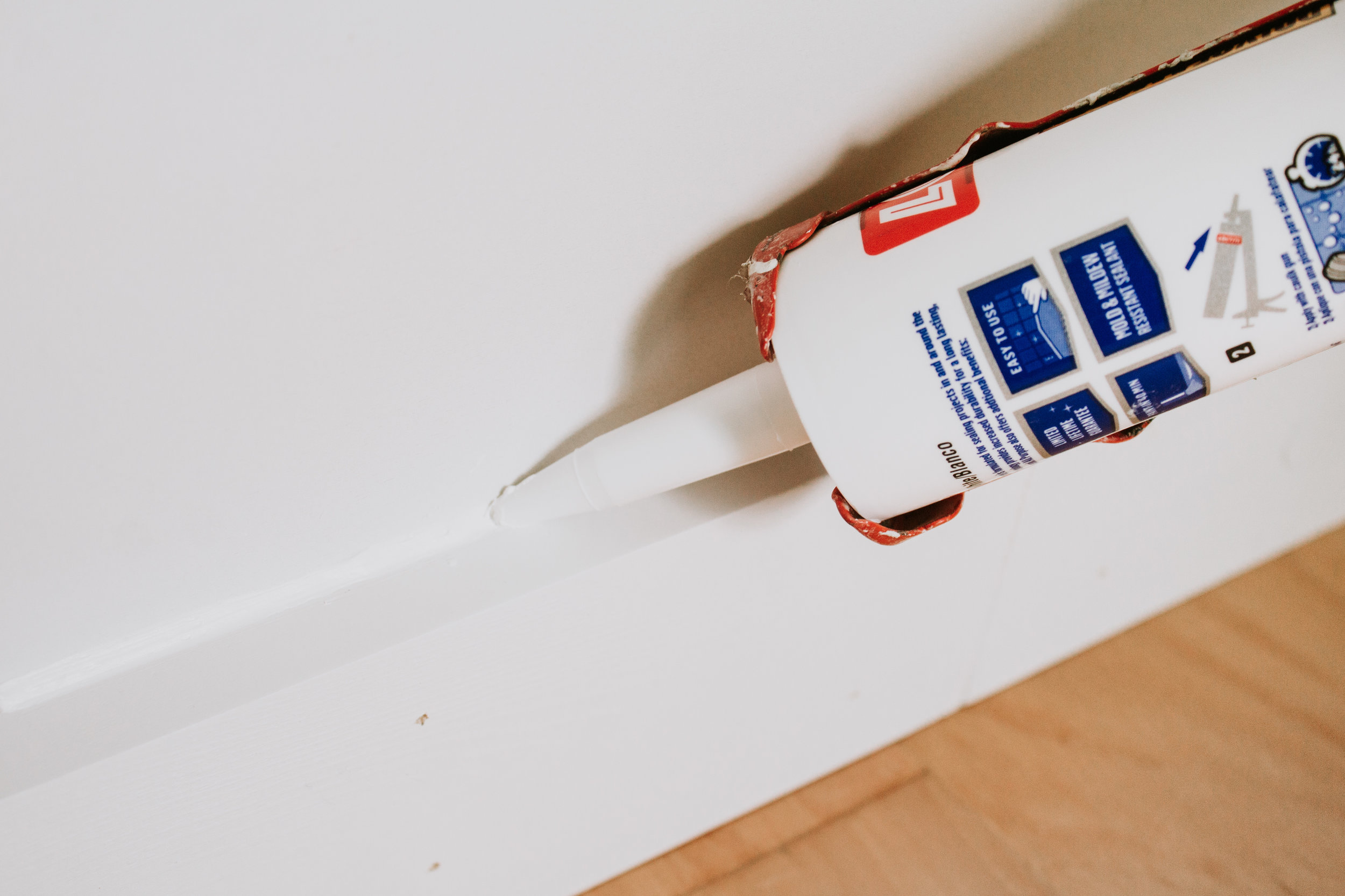 How to Install Floor Trim Like the Professionals - How to cut trim, nail it on the wall, and fill in imperfections. How to fix gaps in floor trim.  Nadine Stay