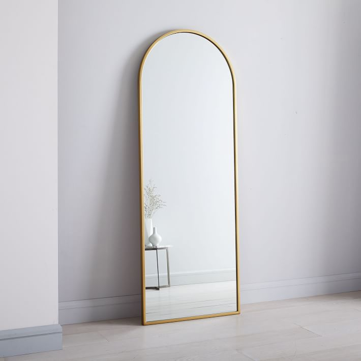 The High/Low List by Nadine Stay - Featuring Brass Accents. High end pieces and their (cheaper) twins. Brass home decor, furniture, and accessories. Brass arched mirror from West Elm.