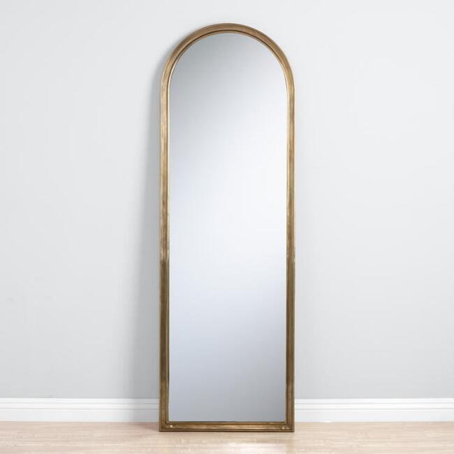 The High/Low List by Nadine Stay - Featuring Brass Accents. High end pieces and their (cheaper) twins. Brass home decor, furniture, and accessories. Brass arched mirror from World Market.