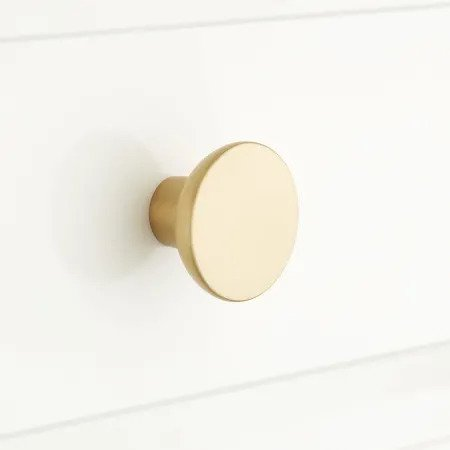 The High/Low List by Nadine Stay - Featuring Brass Accents. High end pieces and their (cheaper) twins. Brass home decor, furniture, and accessories. Brass circle knob from Signature Hardware.