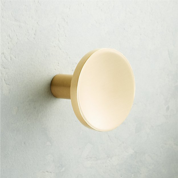 The High/Low List by Nadine Stay - Featuring Brass Accents. High end pieces and their (cheaper) twins. Brass home decor, furniture, and accessories. Brass circle knob from CB2.
