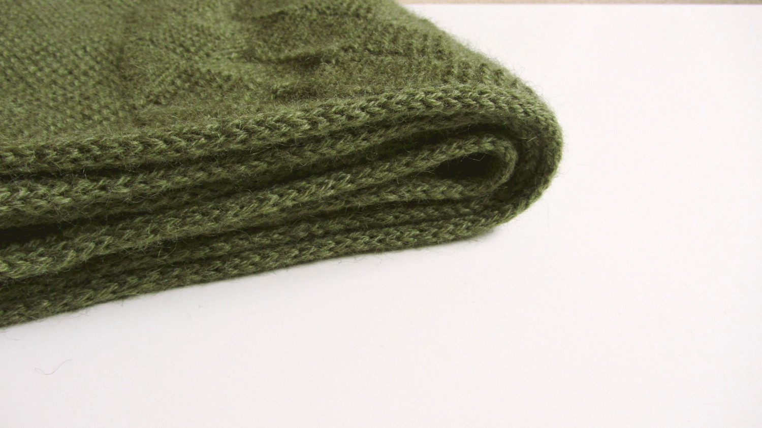 The scarf features tubular selvedges for a minimal, yet elegant edging.