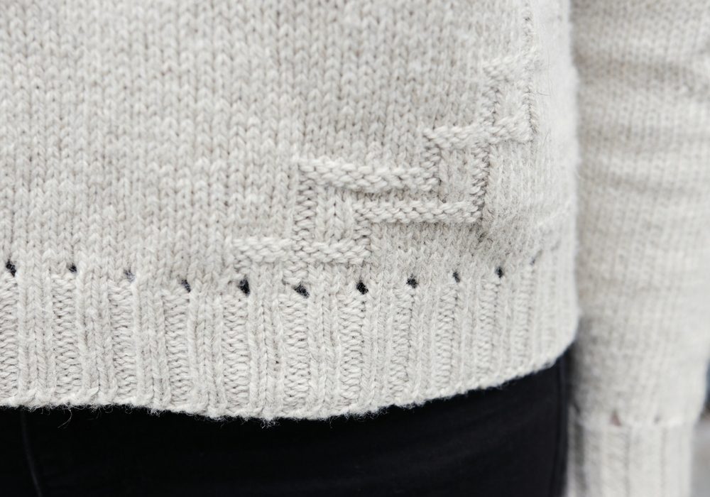 It's all about the details. The hem and cuffs feature an eyelet details above the ribbing.