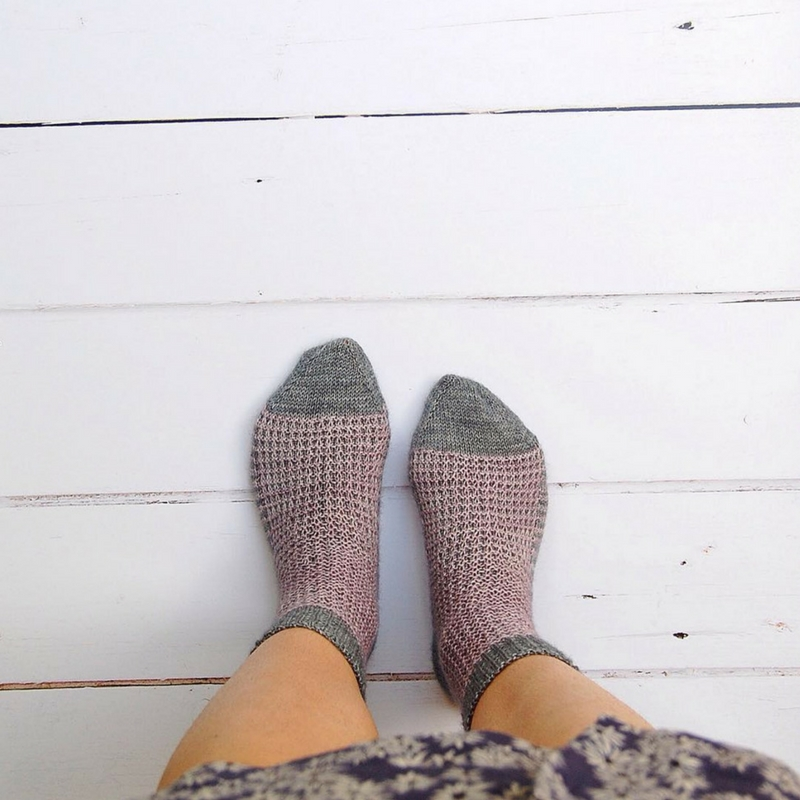One of Sacha's travel-friendly knitting projects - her  Gaufre Socks . If you'd like to knit a pair, scroll down to the bottom of this post to download the free pattern!