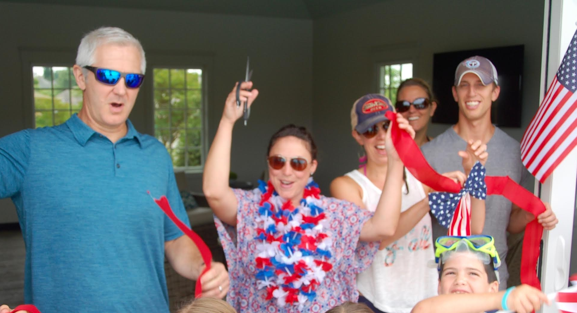 Pictured from left to right are Board members Mike Klein, Amy Silvers, Chrissy Gstell and homeowners, Travis and Jessica Konemann.