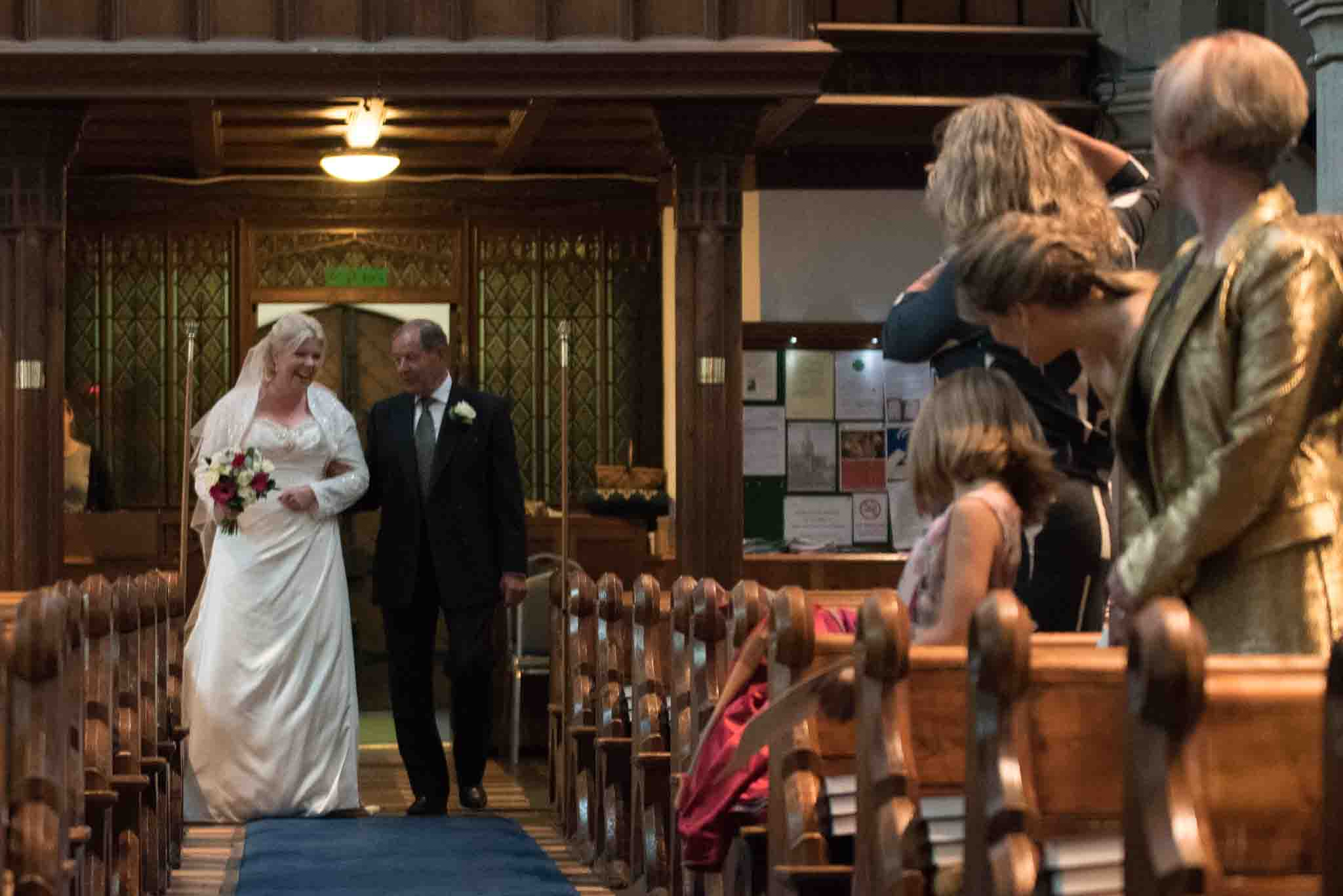 Bride enters St Mary & All Saints Beaconsfield
