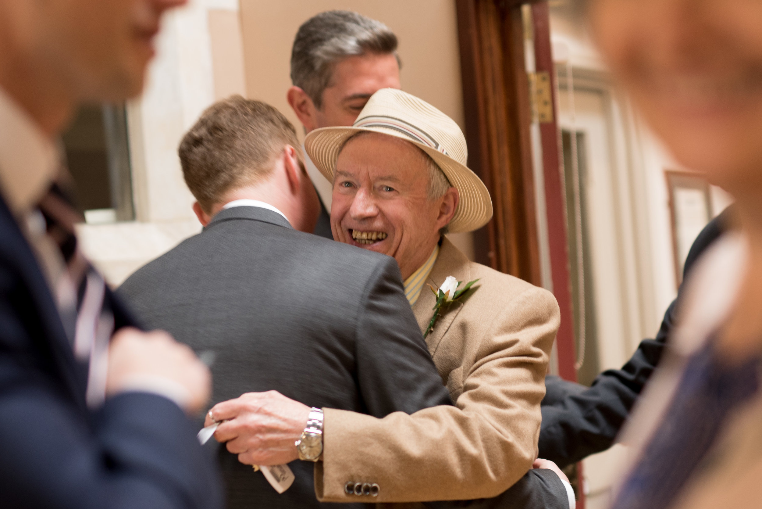 Groom embraces father on wedding day