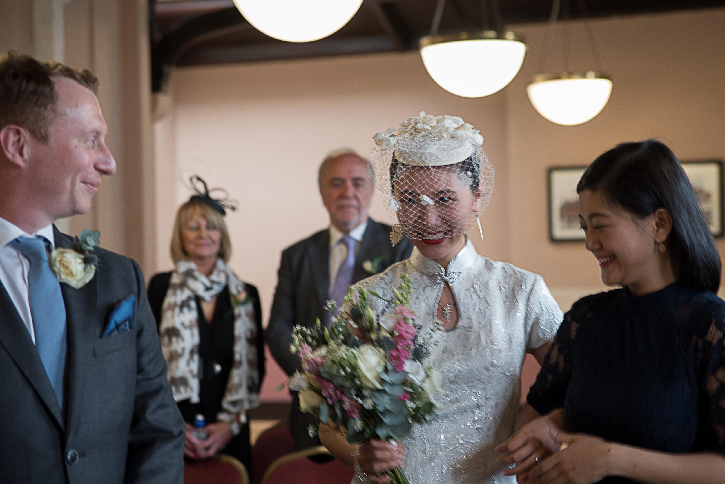 Asian bride walks down the aisle
