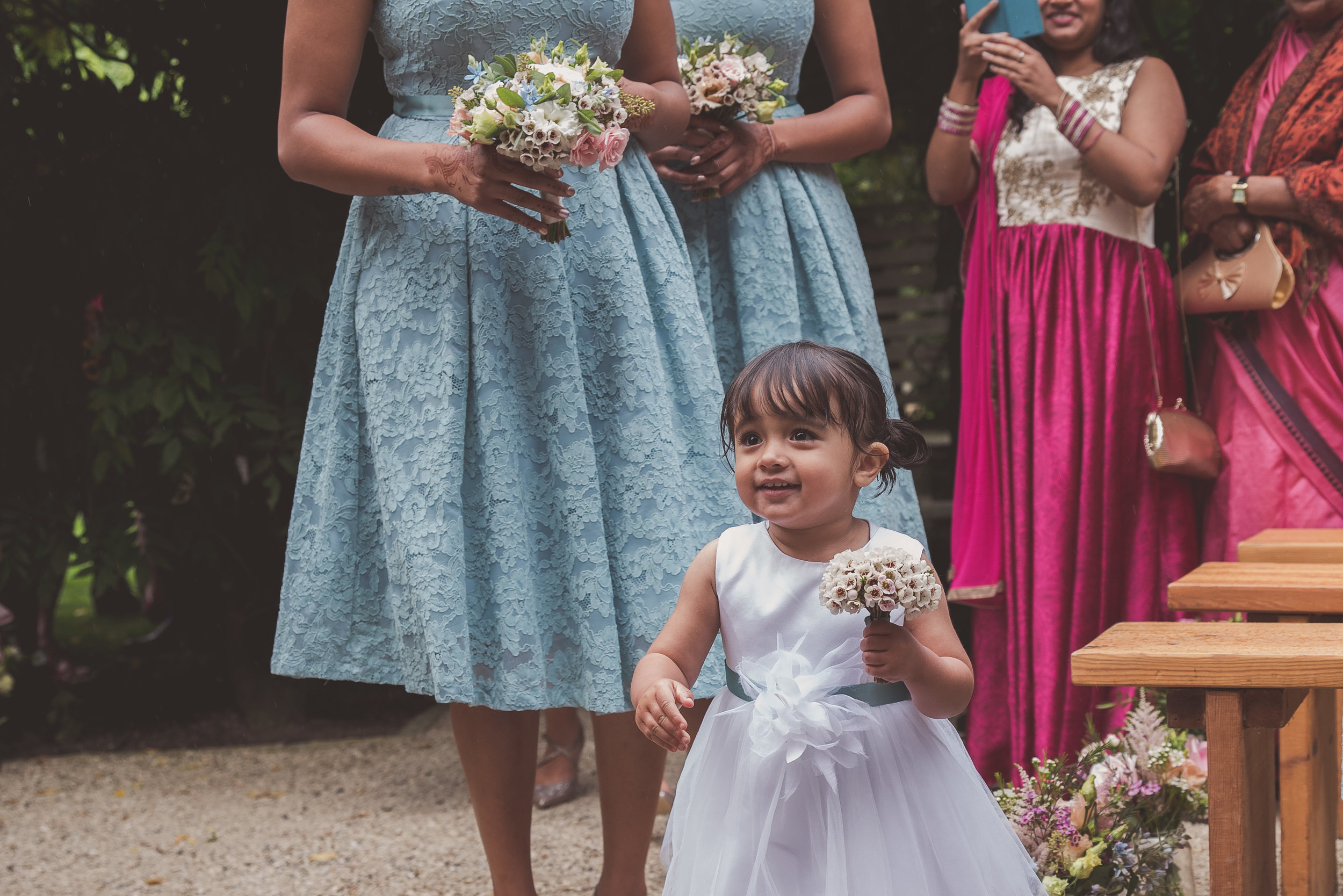 Flower girl at wedding ceremony at The Tythe Barn