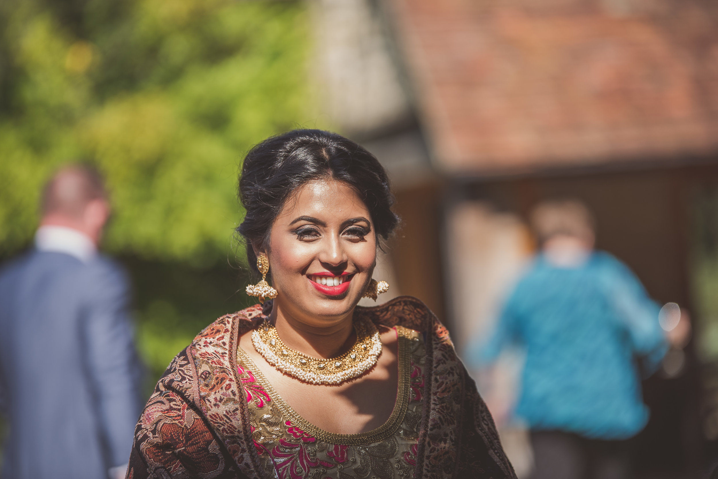 Wedding guest at Hindu wedding at Tythe Barn