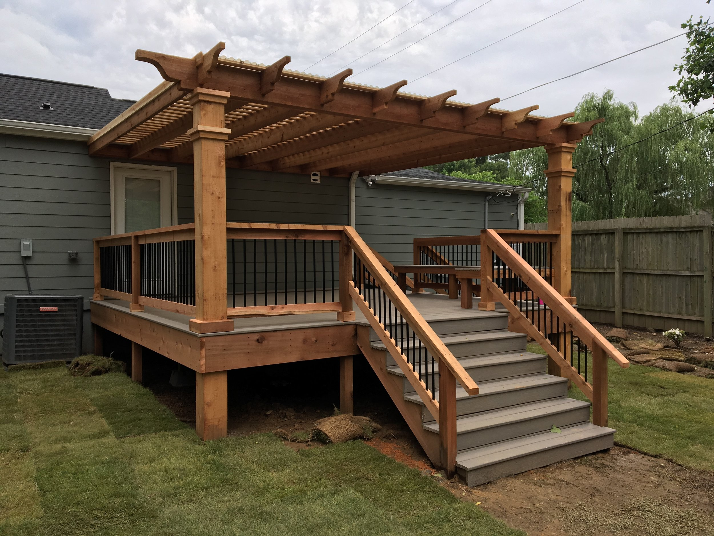 East Memphis Deck/Pergola   This deck, made from Choice-Dek, made the perfect addition to this backyard. We constructed the deck, its cedar handrails, and the attached pergola.