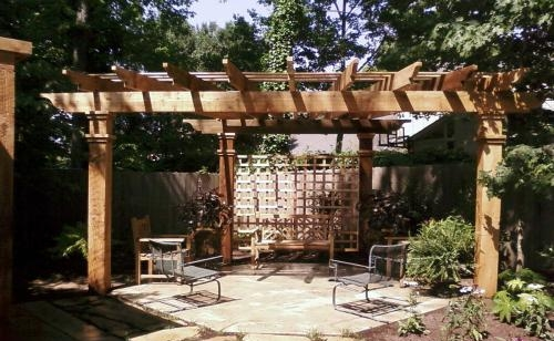 Western Red Cedar Pergola   This free-standing pergola was built on a triangular pad to create a little oasis for the customer to sit and enjoy their backyard.