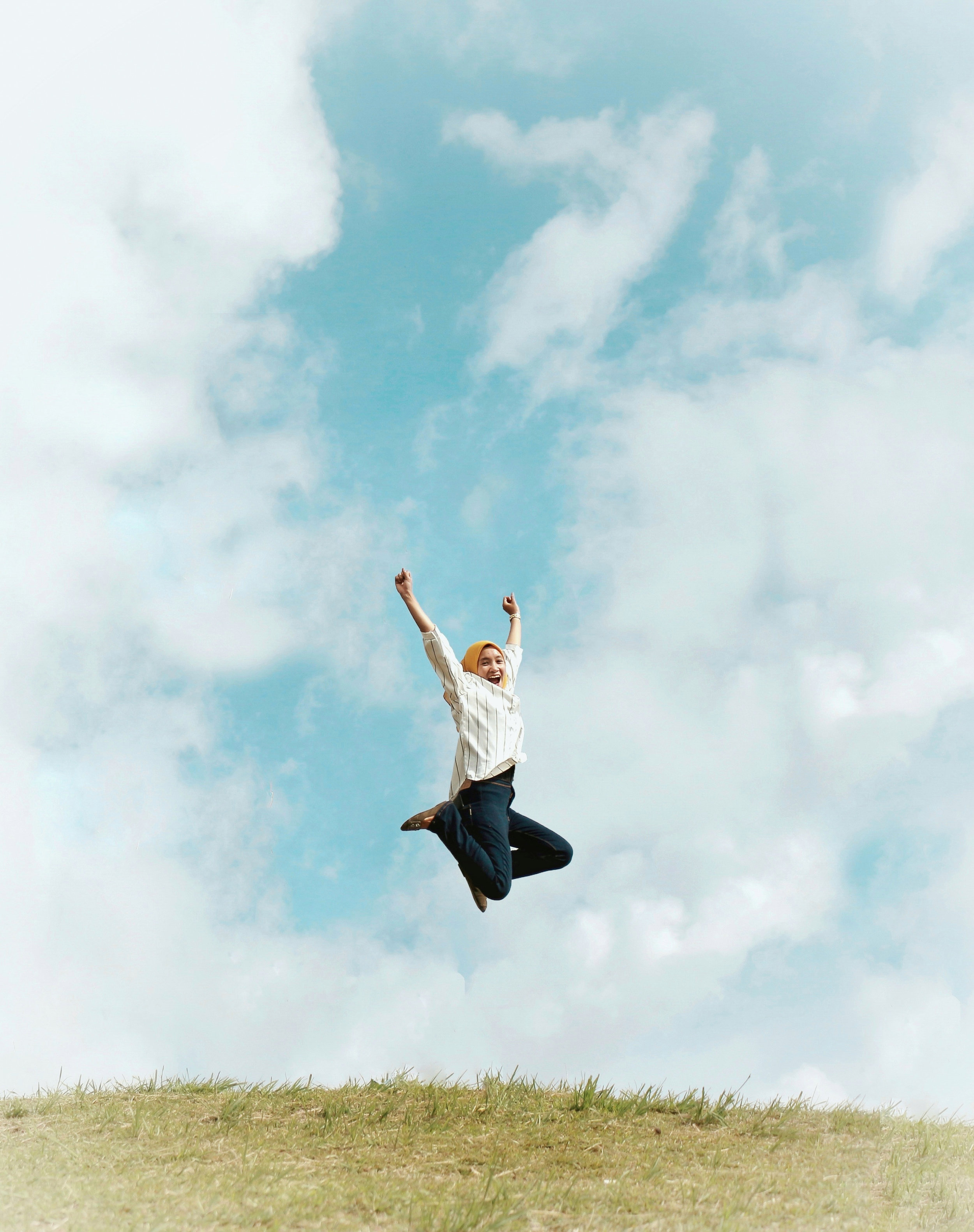 Canva - Person Jumping On Air With Clouds Background.jpg
