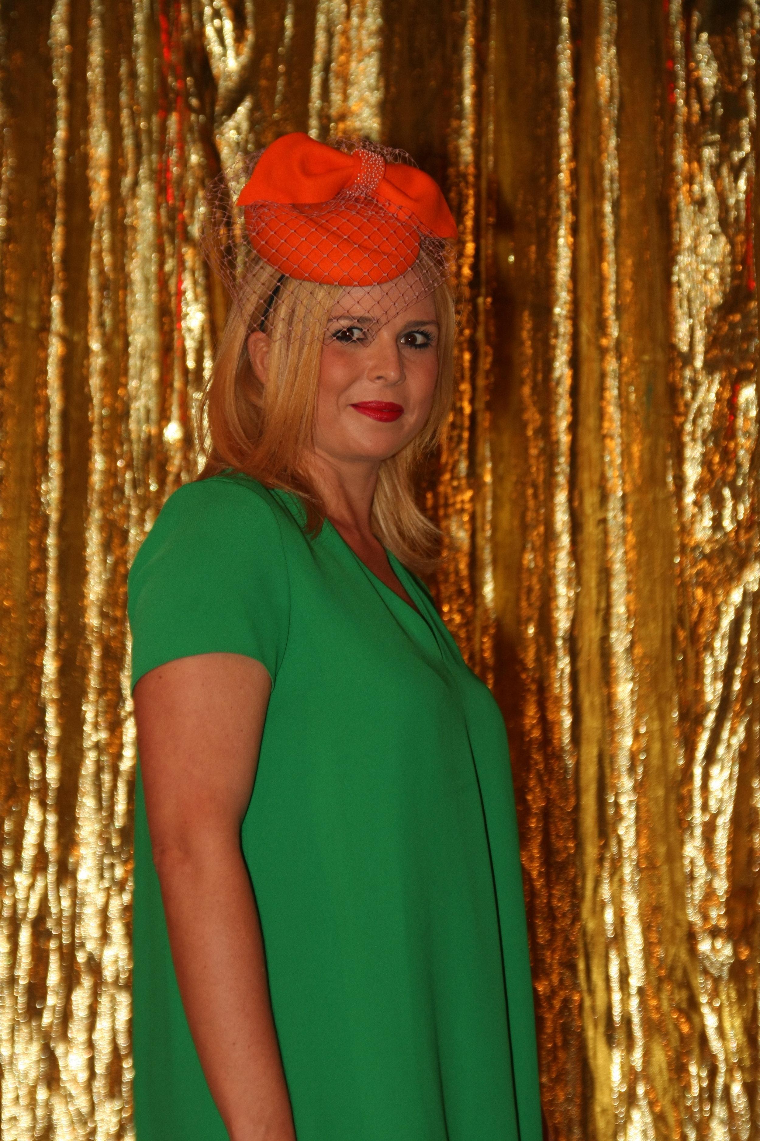 Orange Felt with veiling and beading