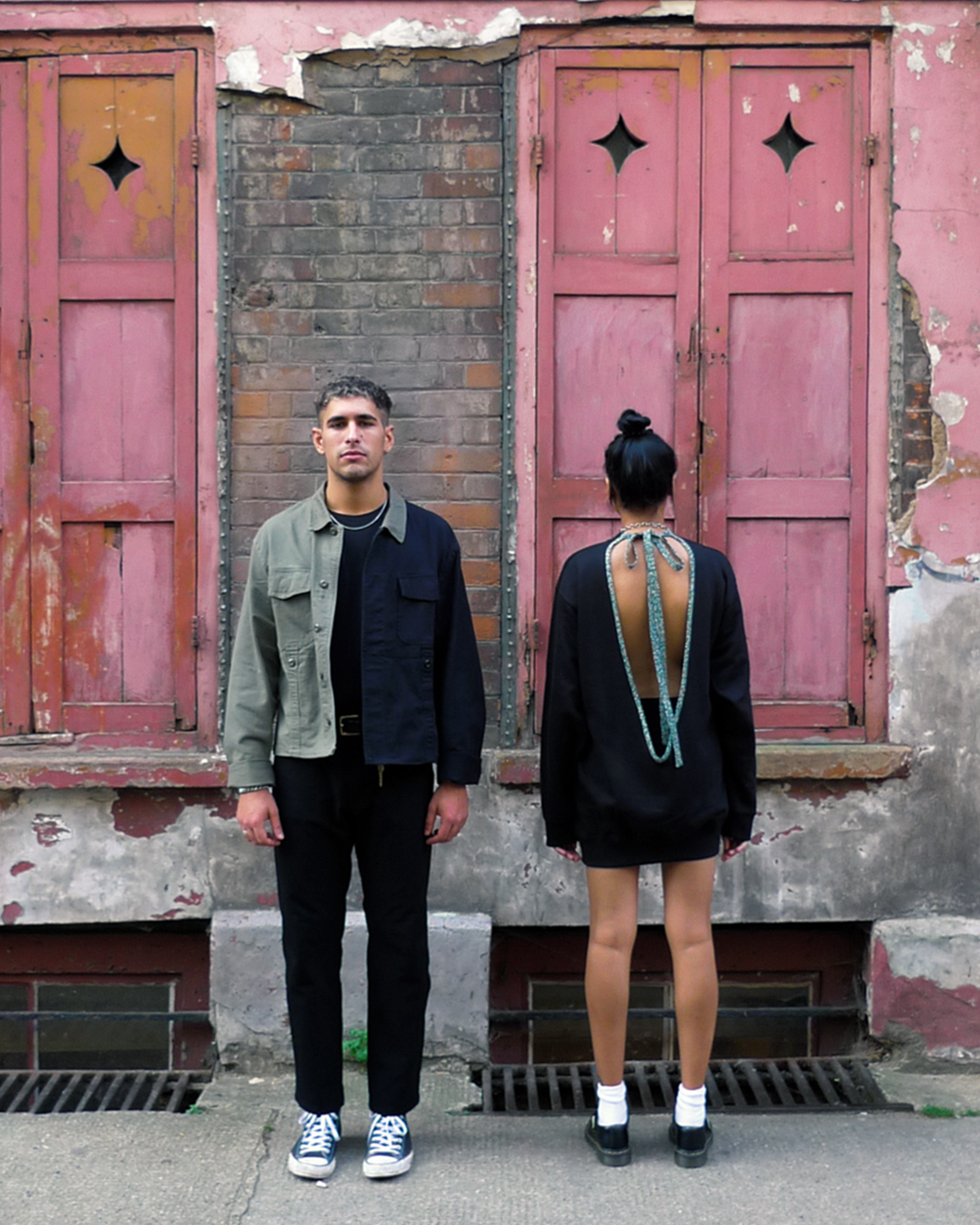 Giacomo wears ATIKA Studio Military Jacket. Reworked from surplus military garments. Sneha wears ATIKA Studio Tie Back Sweater with vintage Kimono detail.
