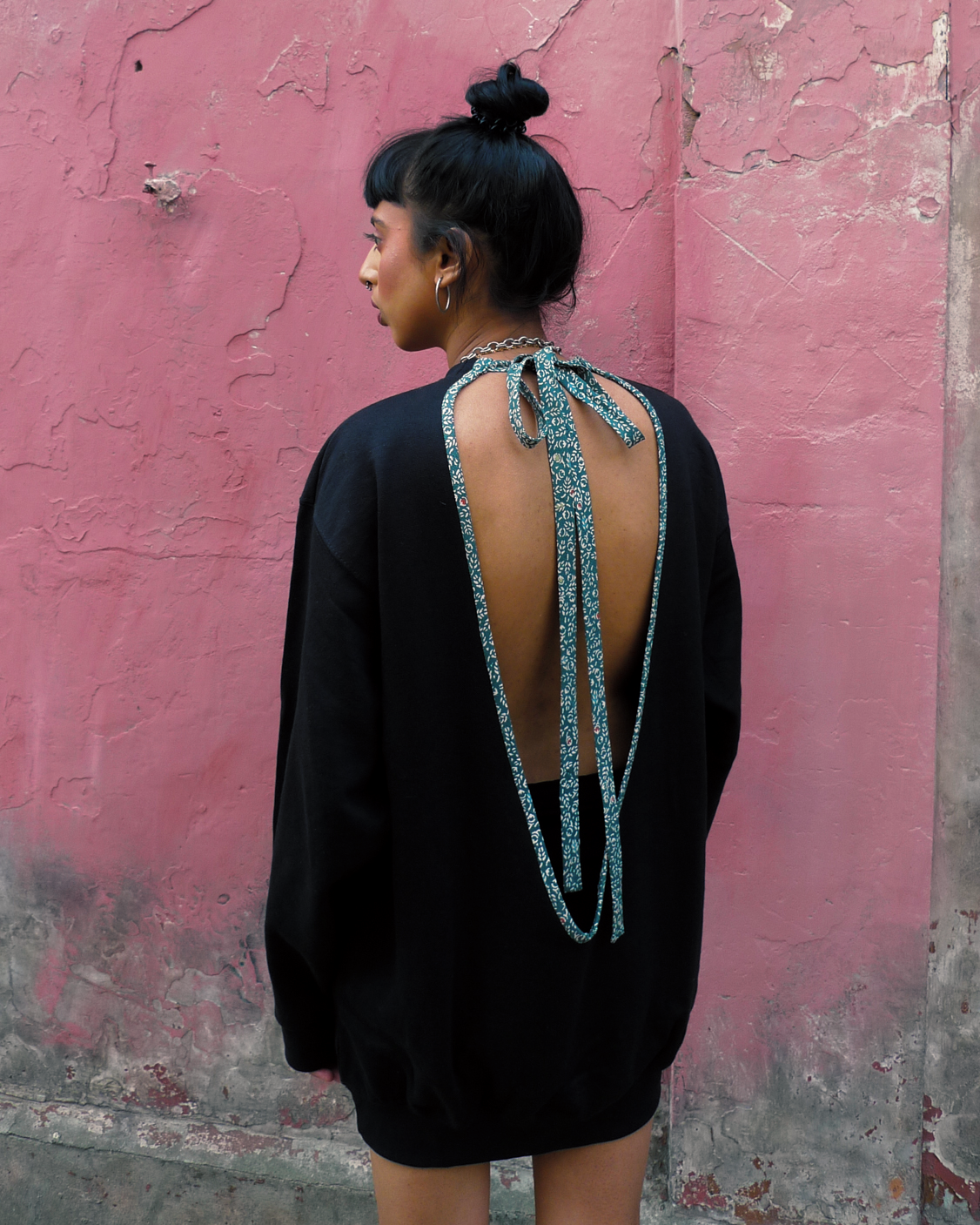 Sneha wears ATIKA Studio Tie Back Sweater with vintage Kimono detail.