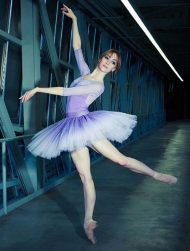 Natalie Varnum, the demi soloist with the Houston Ballet is wearing nui's Classical standard Tanzanite ombre tutu.