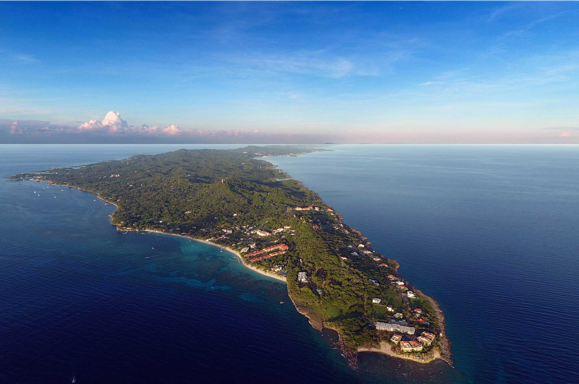 The Western tip of Roatan Island, Bay Islands, Honduras. The beach in the foreground is West Bay, West End to the far left.