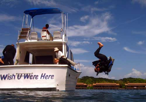 somersault deep water entry performed by PADI srtaff instructor Marc Cruciani