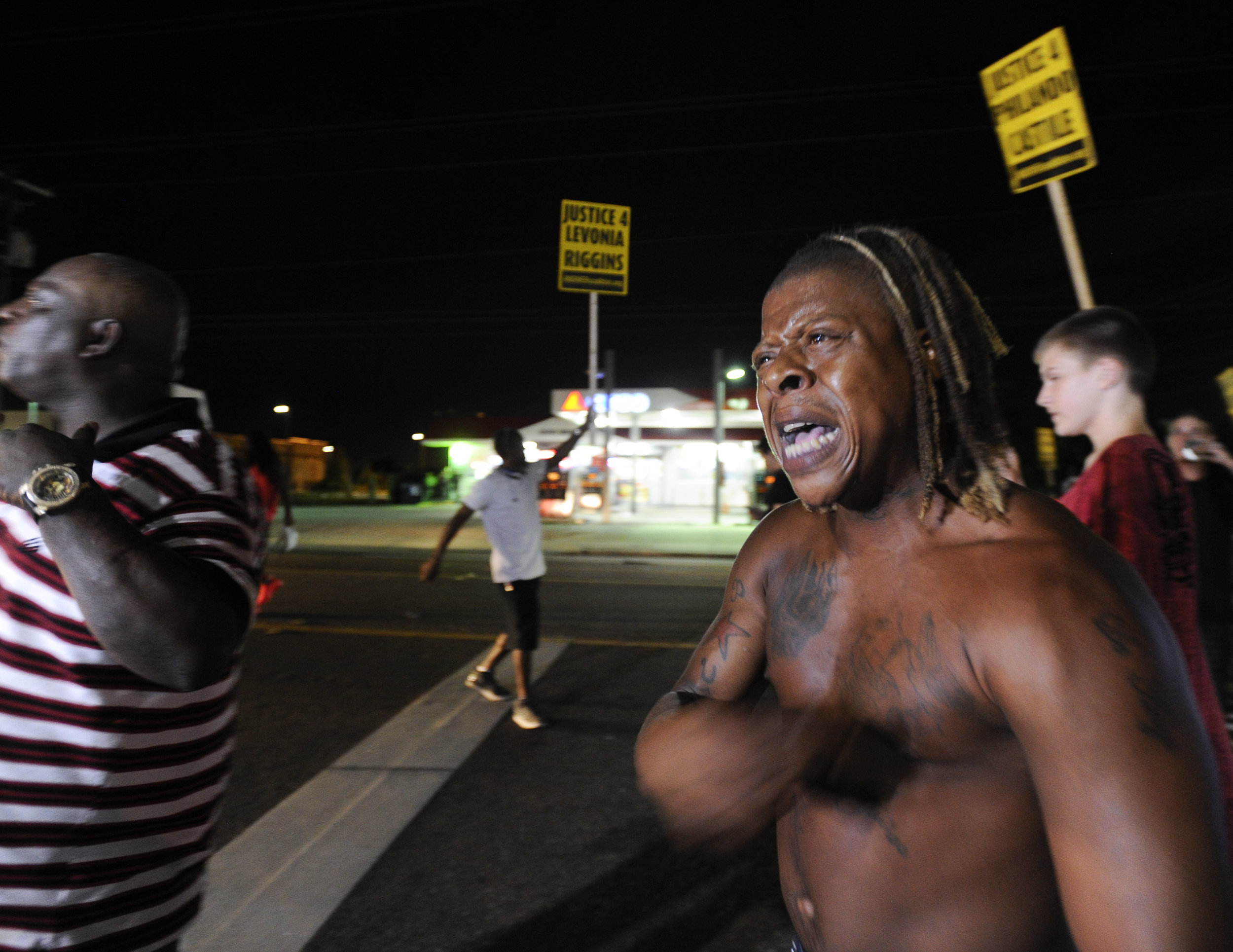 "Darrell Judkins, a 29-year-old from Tampa, yells to the crowd during a gathering outside the Get N Go convenience store on South 78th Street on Sept. 2, 2016, to protest the death of Levonia Riggins, a 22-year-old who was shot by a Hillsborough County Sheriff SWAT deputy on Tuesday. ""It was important for me to make a statement with my people,"" he said."