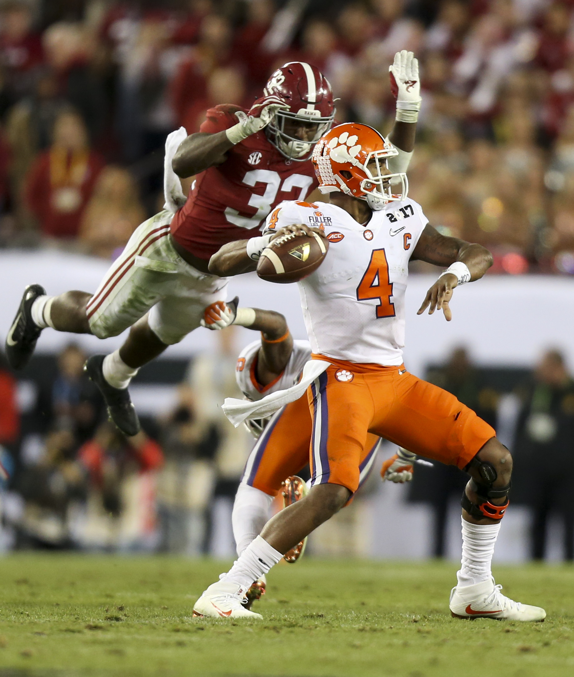 Clemson Tigers quarterback Deshaun Watson (4) prepares to throw the ball as Alabama Crimson Tide linebacker Rashaan Evans (32) leaps to tackle Watson during the second half of the College Football Playoff National Championship game Monday, Jan. 09, 2017 in Tampa. The Clemson Tigers defeated the Alabama Crimson Tide 35-31.