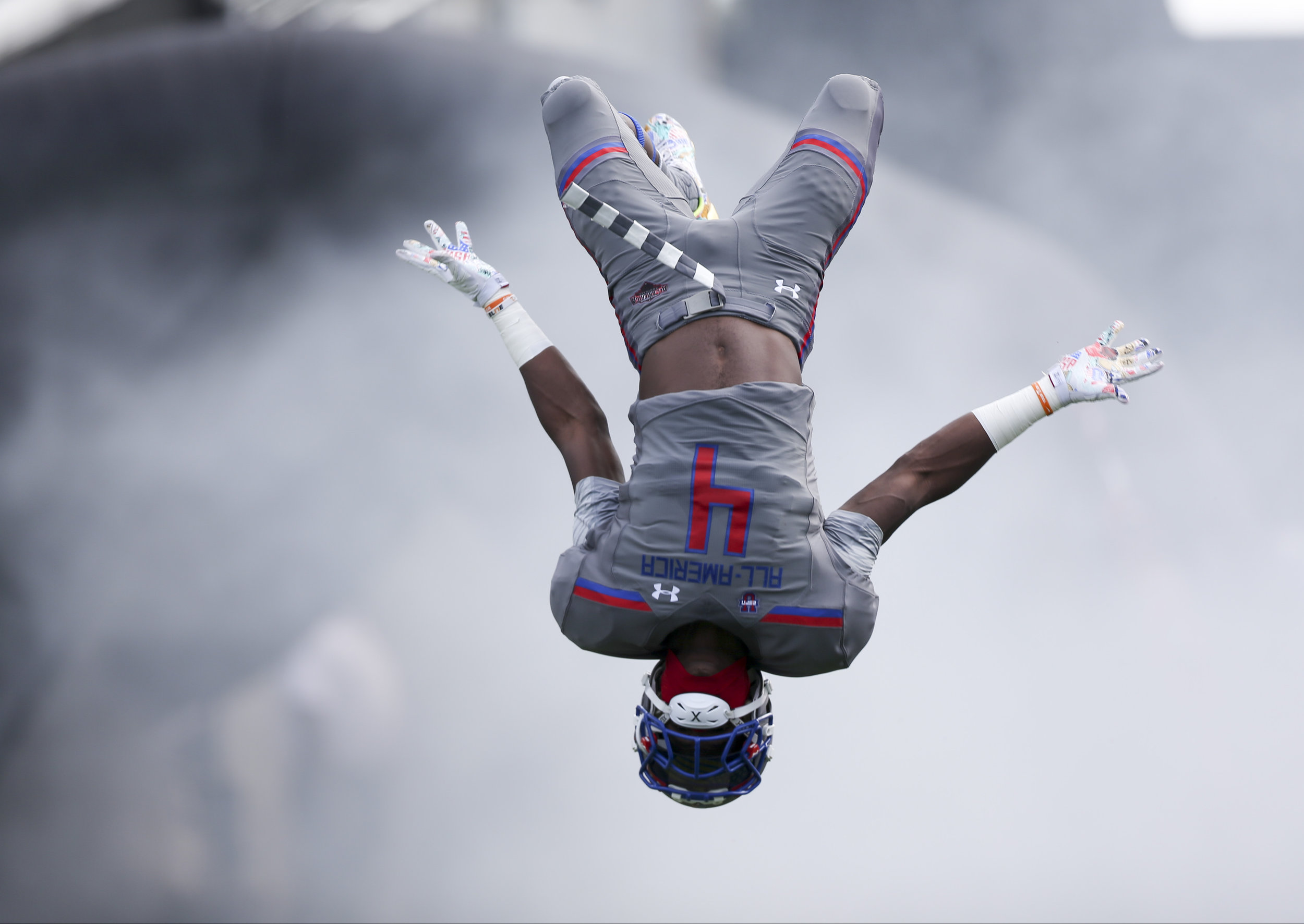 Team Armour offensive linebacker Maleik Gray (04) does a flip during the opening ceremony of the Under Armour All-America Bowl at Camping World Stadium in Orlando, Fla., on Sunday, January 1, 2017. Final score: Armor 24, Highlight 21.