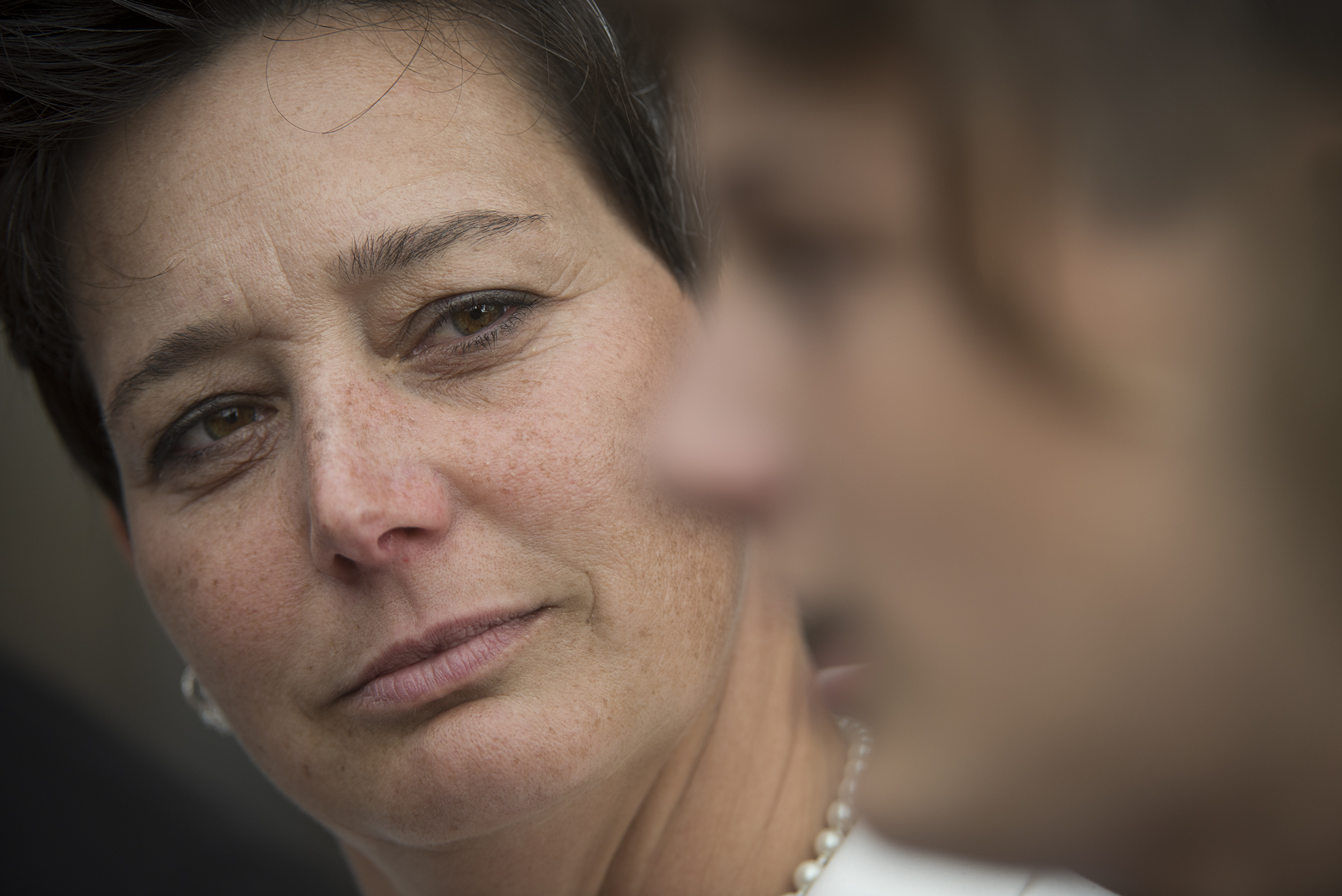 Jacquelyn Jamason watches her son, Ethan, speak to reporters at the Palm Beach County Courthouse on Tuesday, September 26, 2017, in West Palm Beach, Fla. Circuit Judge Charles Burton sentenced Jamason's former partner, Kimberly Lucas, 43, to life in prison for killing the 2-year-old daughter she shared with Jamason, plus an additional 30 years for trying to poison their at-the-time 10-year-old son.