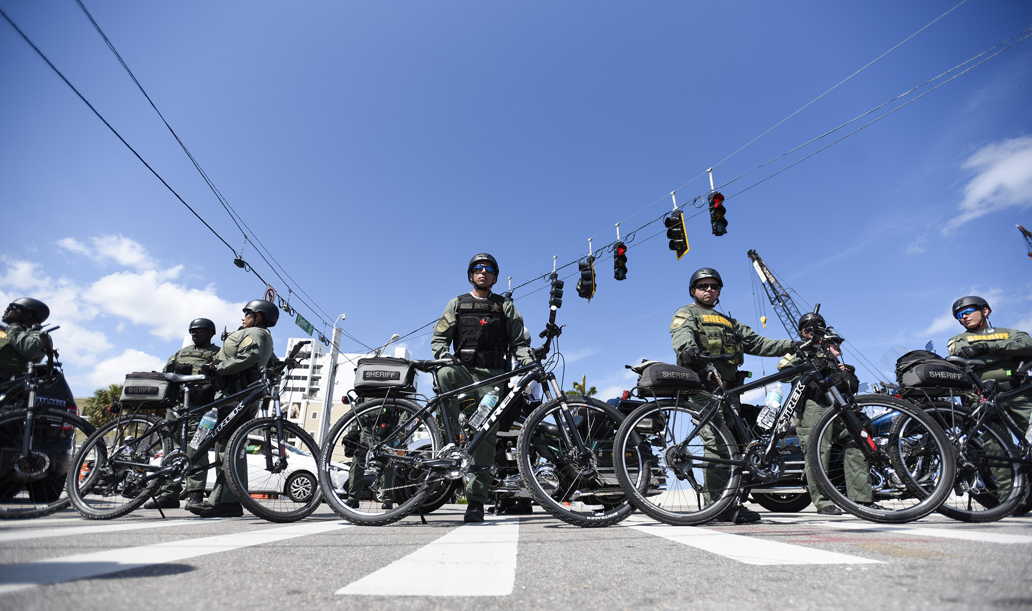 Palm Beach County Sheriff Office bicycle deputies are lined up at the corner of Southern Boulevard and South Flagler Drive during the March for Our Lives demonstration in West Palm Beach, Fla., on Saturday, March 24, 2018.