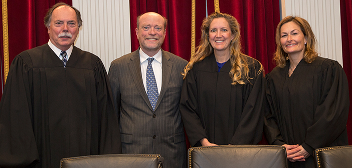 Federal Circuit Judges Richard Linn (L'69), Kimberly Moore (L'94), Kara Stoll (L'97) and Dean William Treanor