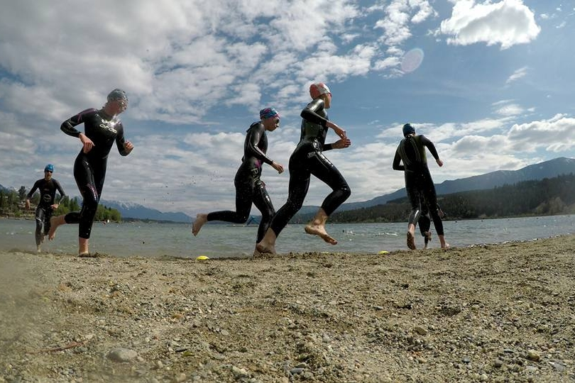 youth triathletes training in open water swimming