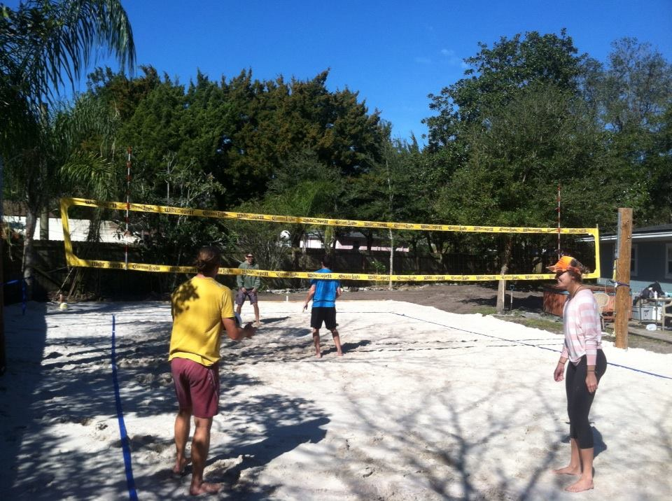 Sand volleyball court in the backyard final product.
