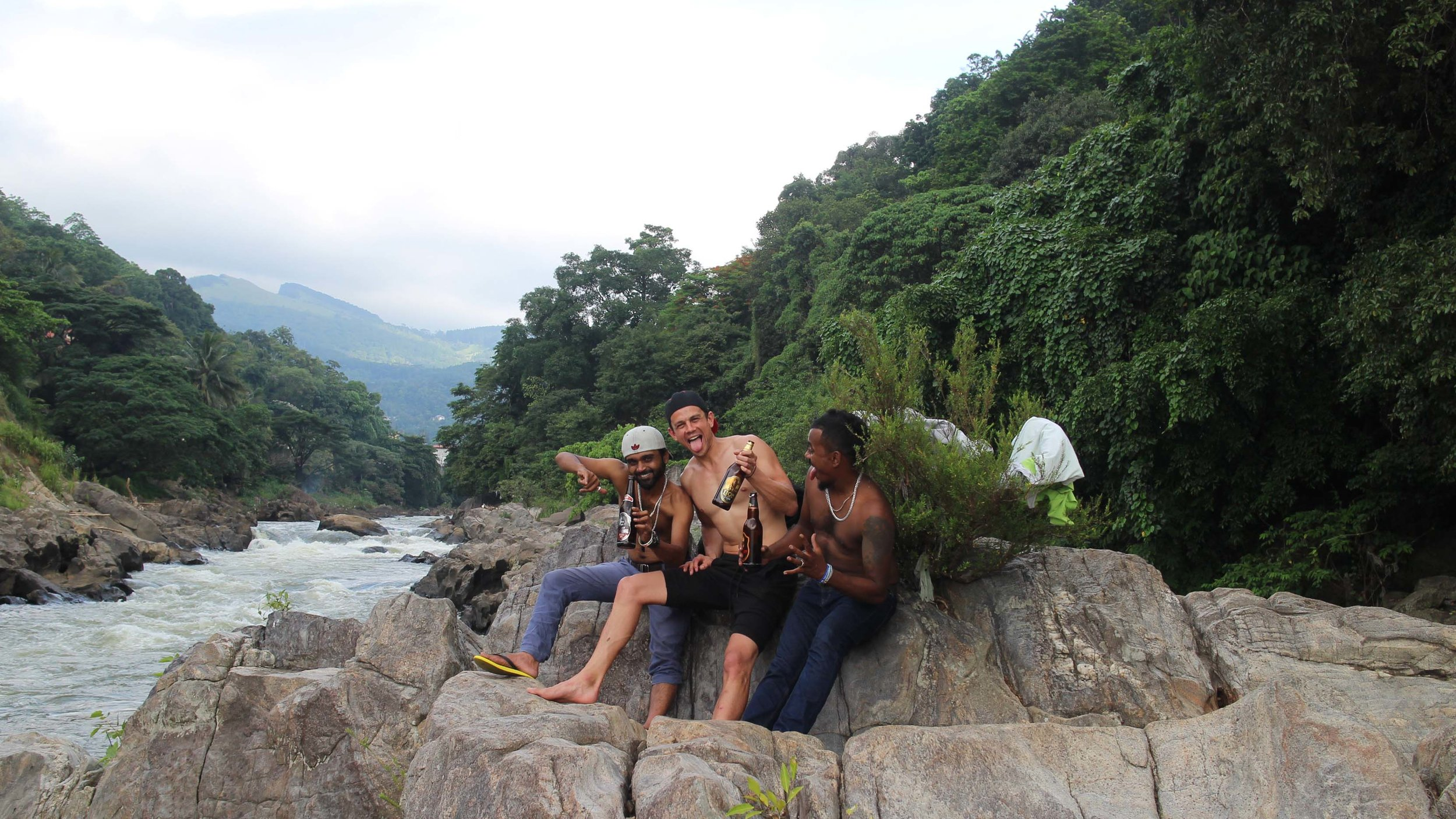 Saapu, Me & Chana drinking by a river somewhere in Kandy.