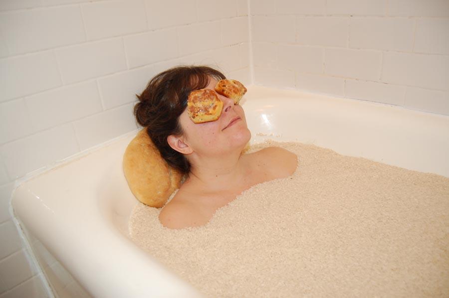 Bath  from the series  Carbs Feel Good,  2018, bathtub, rice, cinnamon buns, homemade bread loaf, dimensions variable