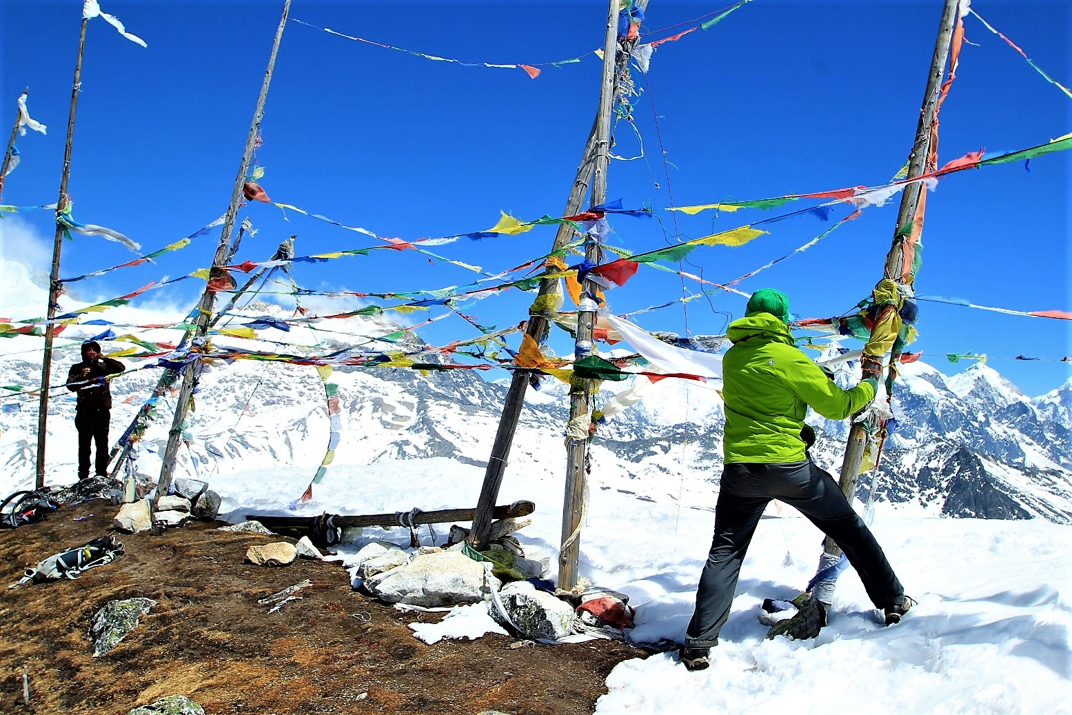 Hanging prayer flags on top of Tserko Ri