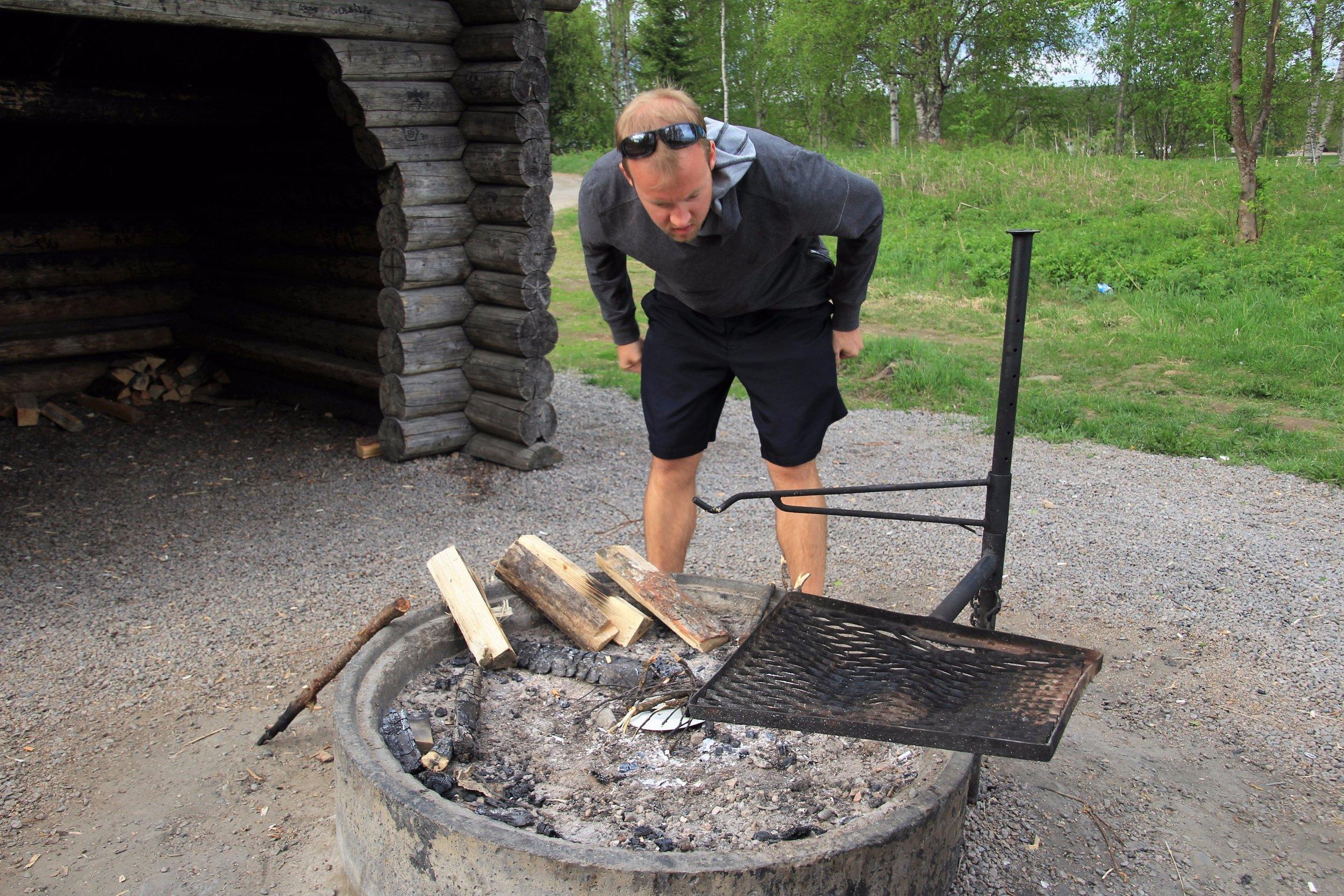 man making fire...