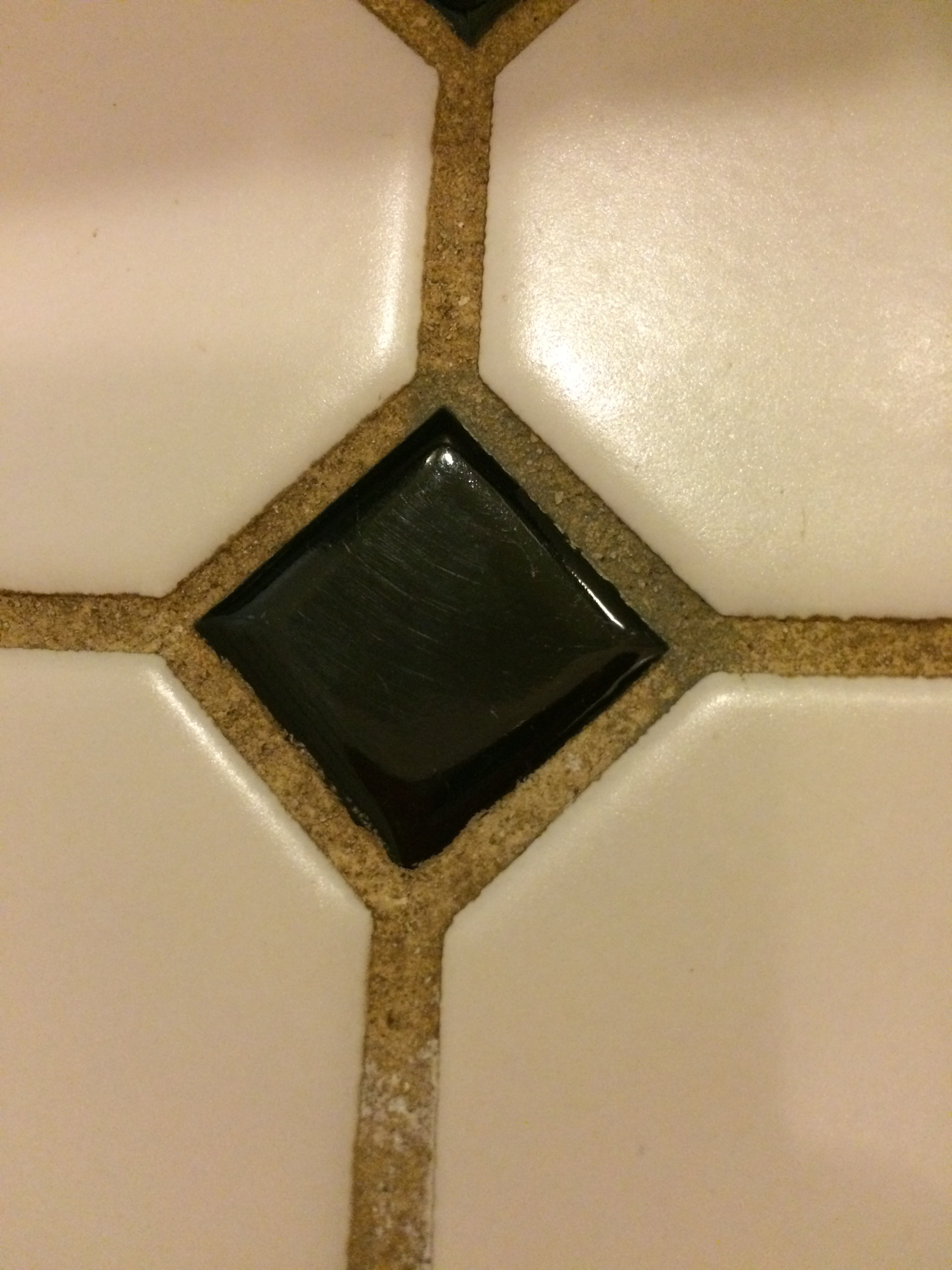 One of the darkest stained portions of the grout. On the top right of the diamond you can see the Grout Renew before I finished the area.