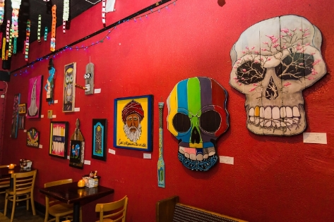 Rojo is covered with quirky skull decorations. Photo courtesy of Rojo's  website .