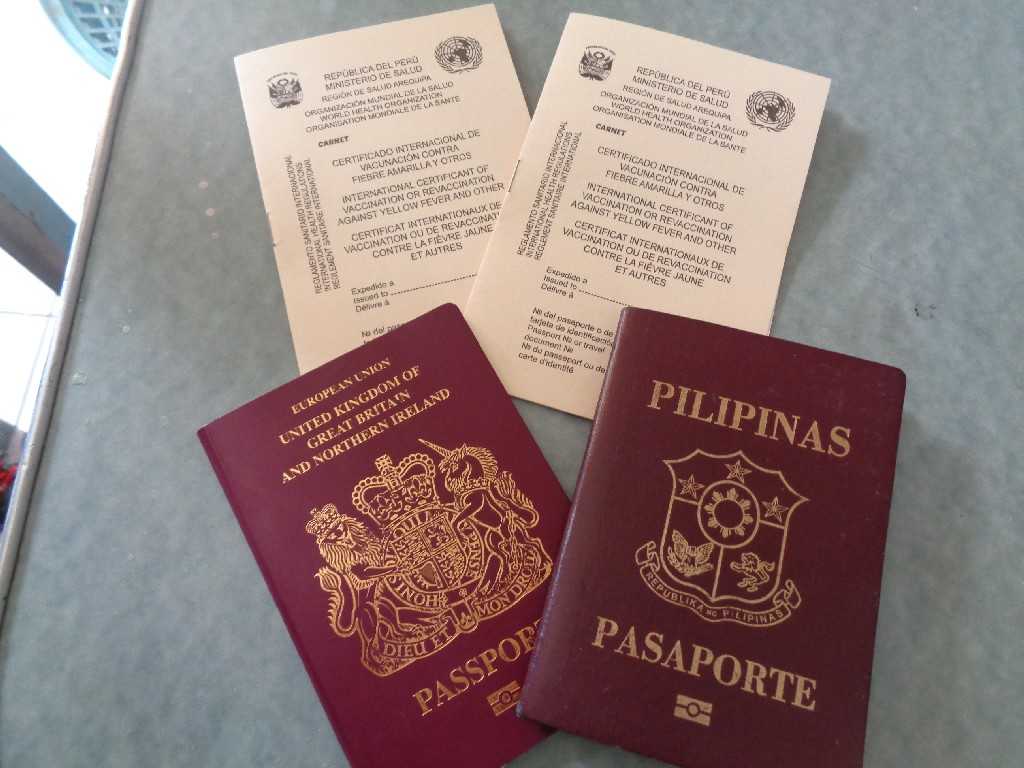 Jonathan's British Passport and my Philippines Passport with our Yellow Fever vaccine card.