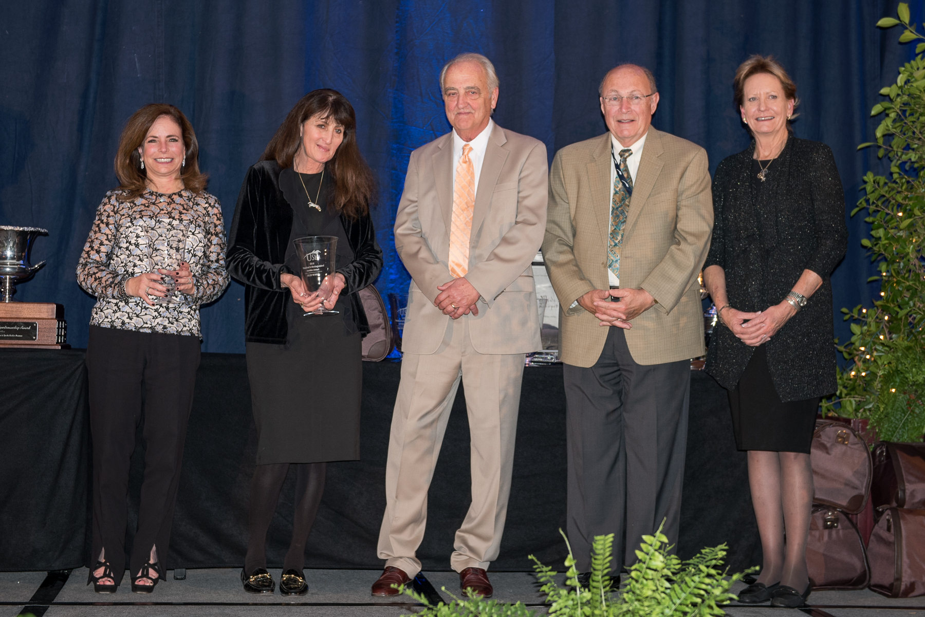 Julie Winkel, second from left, received a USHJA President's Distinguished Service Award during the USHJA Annual Meeting. She's pictured with fellow award winners, from left, Cheryl Rubenstein, Joe Dotoli, Howard Pike and Kathy Meyer.