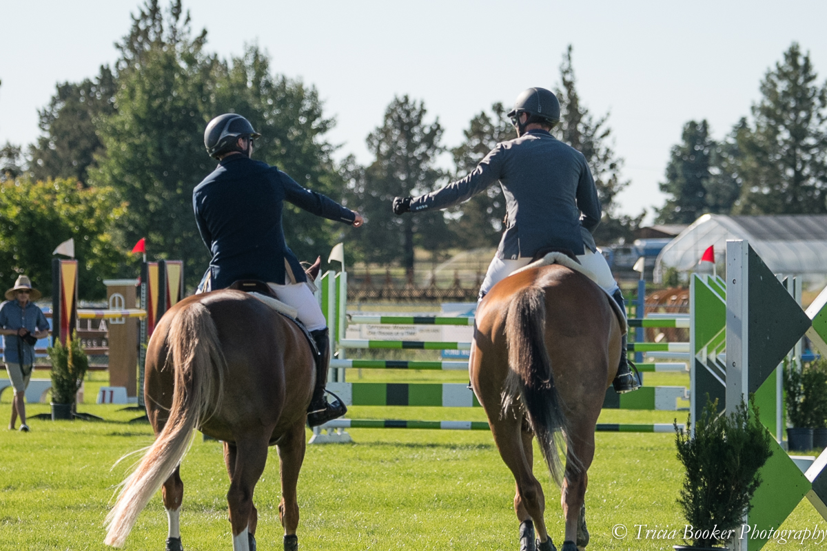 Kevin Winkel and Osophia, left, and Andrew Jayne with Outlier fist pump during the $25,000 Oregon High Desert Classic Grand Prix