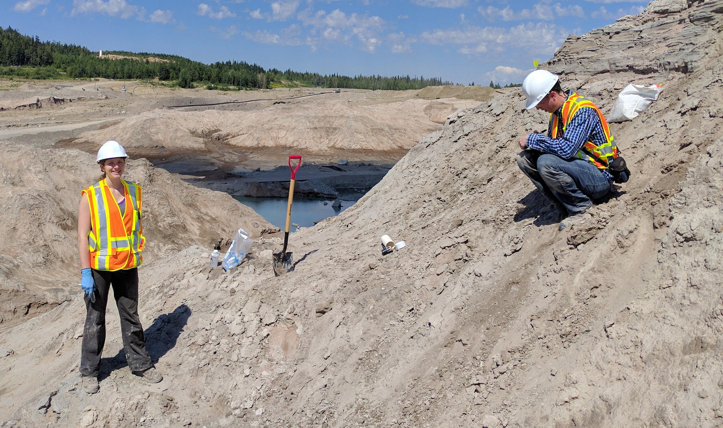 Ian takes notes while Kate pauses from tailings sampling to pose for a snapshot!