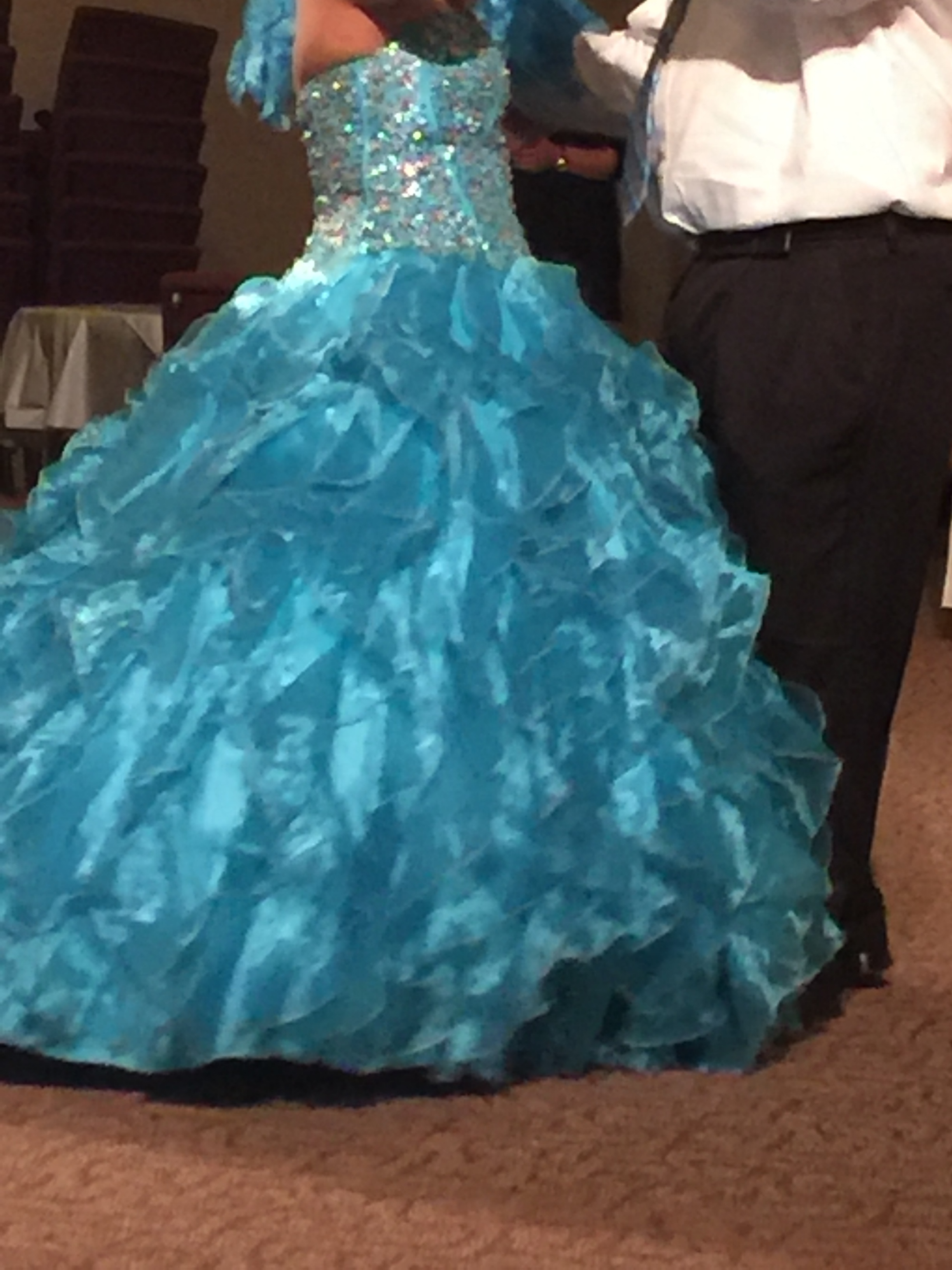 Quinceanera! - CPCH strives to keep our resident's cultural traditions. Recently, one of our girls celebrated her fifteenth birthday with a Quinceanera. This is a Latin tradition held throughout the America's and beyond. She is pictured here during the traditional dance with a beautiful dress provided by caring donors. It was a wonderful evening where we were able to celebrate her, reflect on her accomplishments so far and help her look to the future with hope.THANK YOU TO ALL THE DONORS AND VOLUNTEERS WHO HELPED MAKE THIS A NIGHT TO REMEMBER!