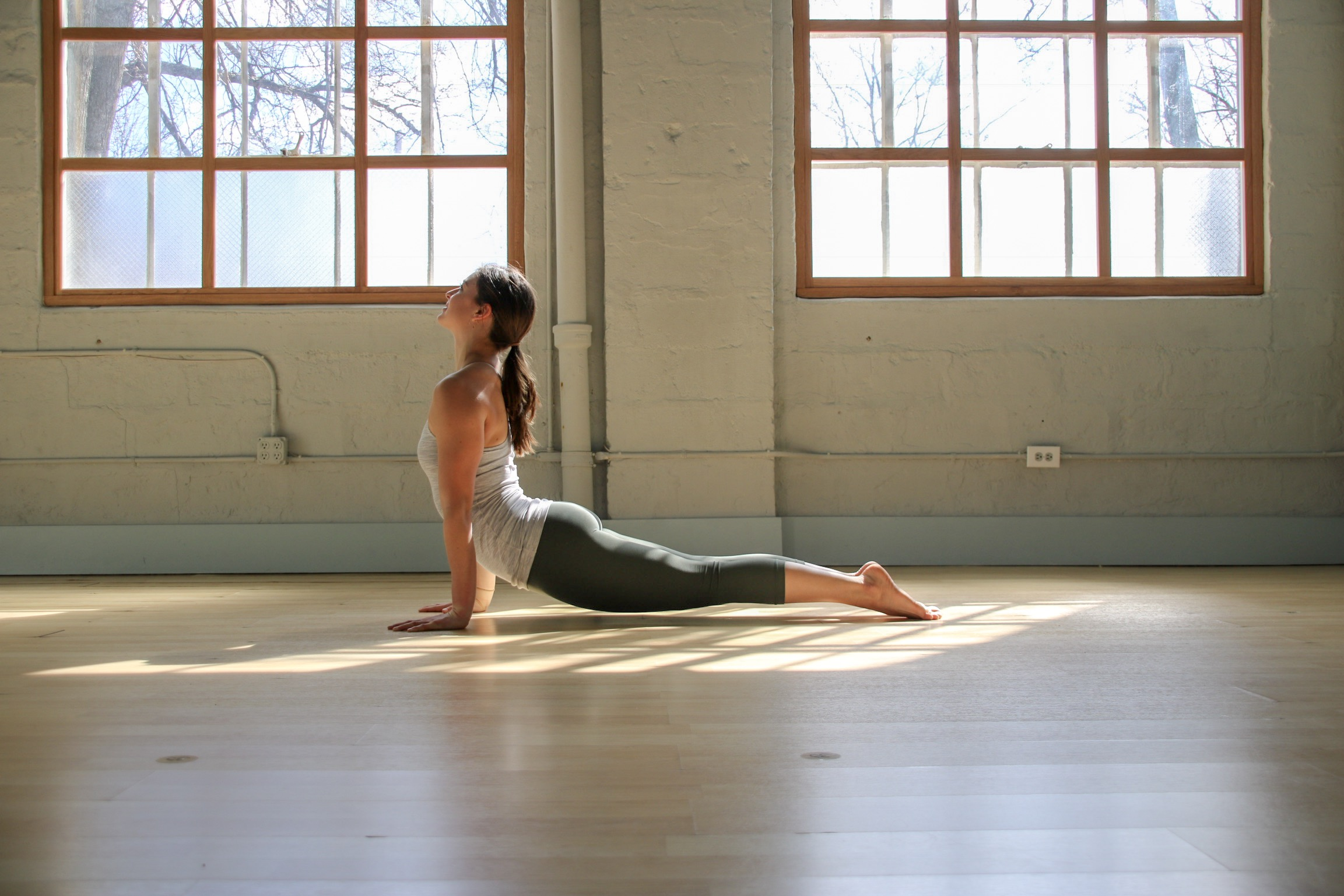 How to practice: From downward dog, shift your hips forward to high plank. Keeping the elbows straight, lay the tops of the feet flat, let hips sink down toward the floor. Keep your chest broad and lifted, drawing collar bones wide, draw belly button to spine and keep the abdominals engaged.