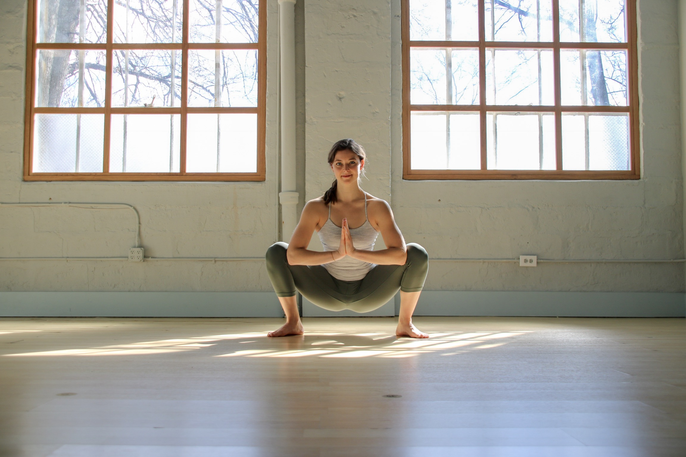 How to practice: Step feet wider than hip width distance, maybe as wide as your mat. Turn the toes out at an angle and sit the hips low. Keep the chest lifted and take hands to prayer at heart center.