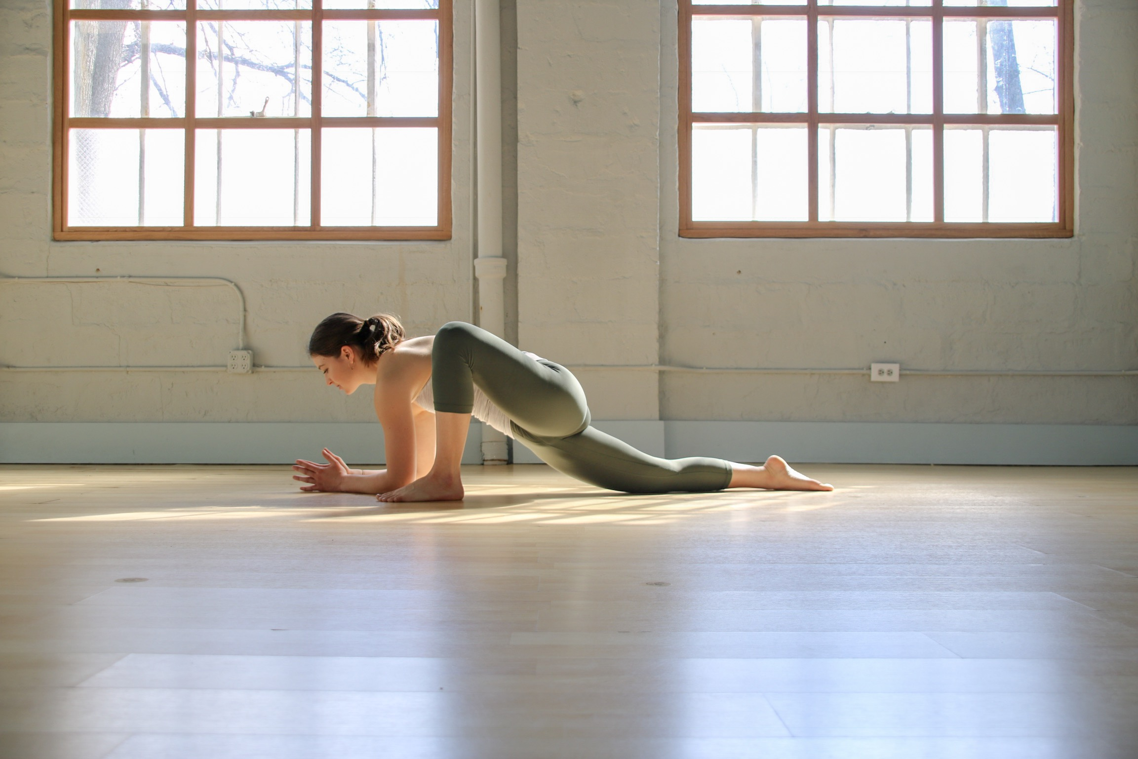 How to practice: From yogi squat, take both hands to the floor between the feet. Step the left foot back and lower hands or forearms to the floor or a block. Take hands to the mat and return to yogi squat to switch sides.