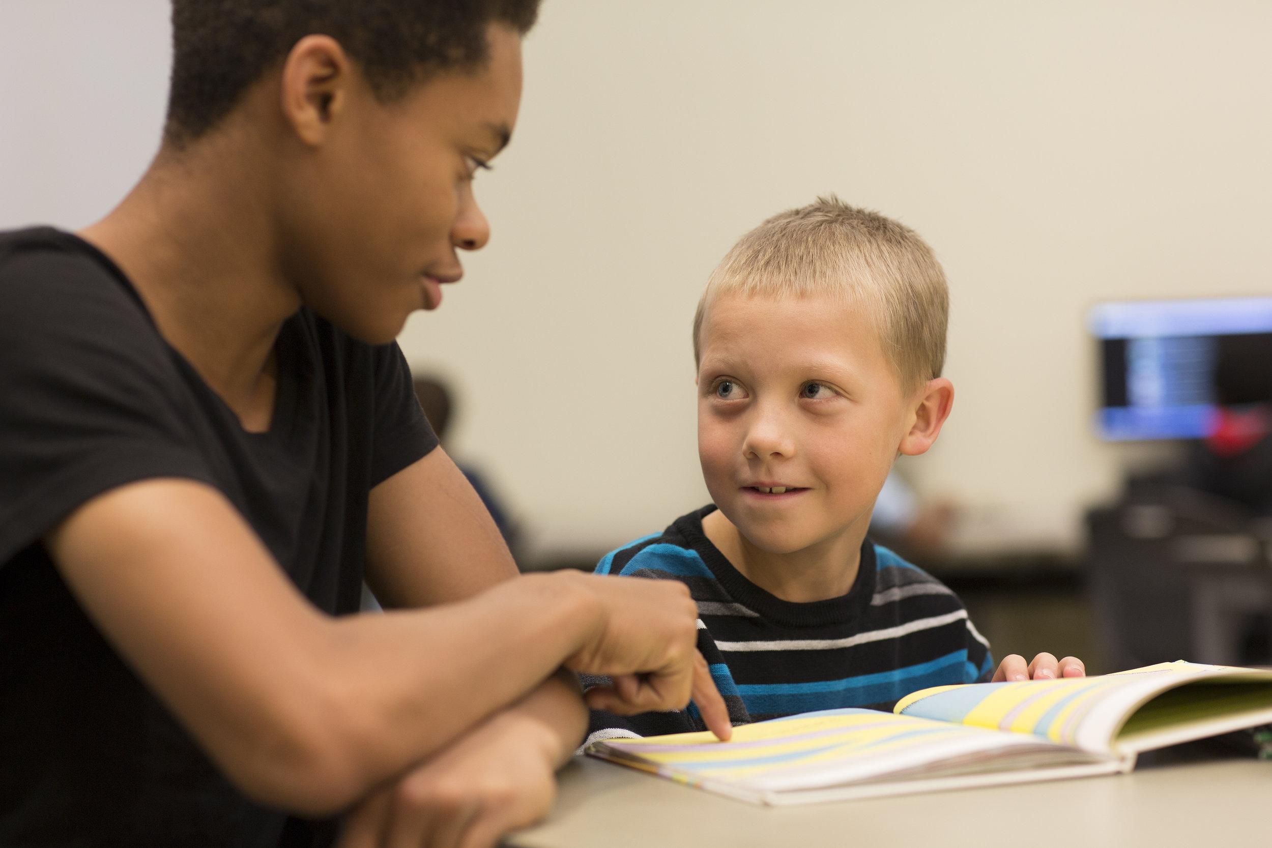 ClubPhotos_MENTOR_H_Teen+Boy_Teaching.jpg