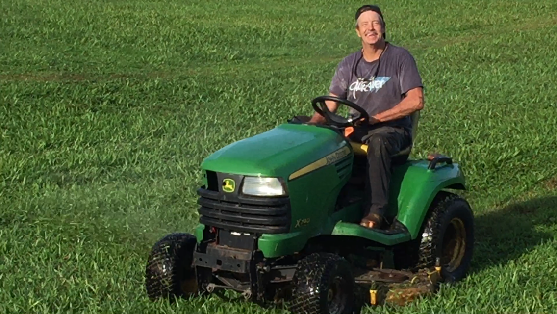 Mel taking the mower out for a spin after fixing it.