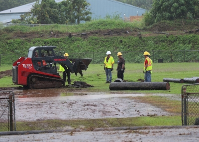Hawaiʻi Electric Light volunteers worked in pouring rain.